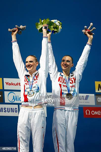 Gold medallists Natalia Ishchenko and Svetlana Romashina of Russia celebrate during the medal ceremony for the Women's Duet Free Synchronised...