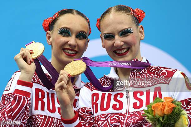 Gold medallists Natalia Ishenko and Svetlana Romashina of Russia pose on the podium following the medal ceremony for the Women's Duets Synchronised...