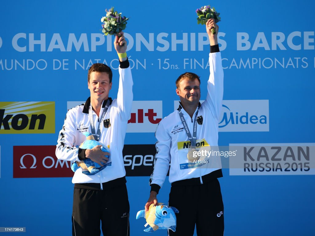 Gold medallists Patrick Hausding and Sascha Klein of Germany pose on the podium after winning the Men's 10m Platform Synchronised Diving final on day two of the 15th FINA World Championships at Piscina Municipal de Montjuic on July 21, 2013 in Barcelona, Spain.