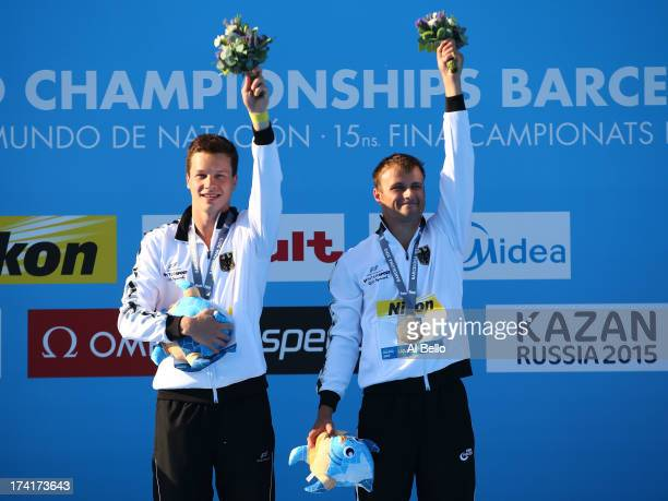 Gold medallists Patrick Hausding and Sascha Klein of Germany pose on the podium after winning the Men's 10m Platform Synchronised Diving final on day...