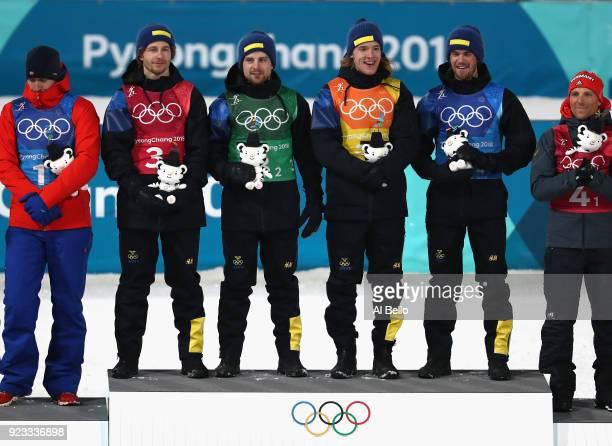 Gold medallists Peppe Femling Jesper Nelin Sebastian Samuelsson and Fredrik Lindstroem of Sweden celebrate during the victory ceremony for the Men's...