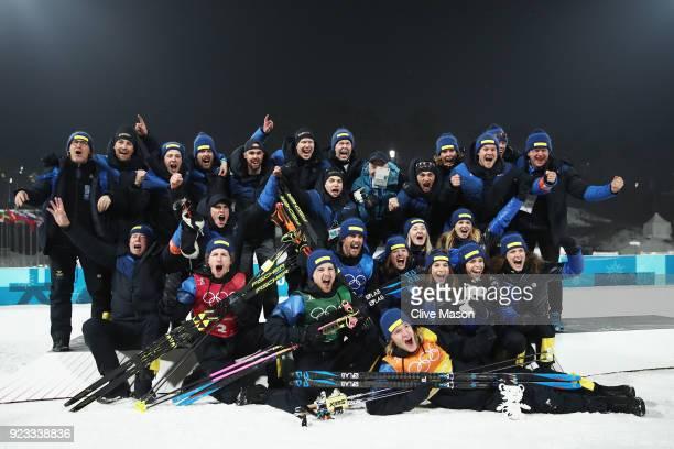 Gold medallists Peppe Femling Jesper Nelin Sebastian Samuelsson and Fredrik Lindstroem of Sweden celebrate with their team during the victory...