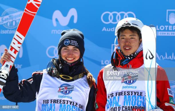 Gold medallists Perrine Laffont of France and Ikuma Horishima of Japan pose after the Dual Moguls on day two of the FIS Freestyle Ski and Snowboard...