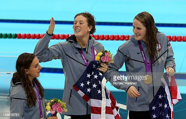 Gold medallists Rebecca Soni Allison Schmitt and Missy Franklin of the United States celebrate following the medal ceremony for the Women's 4x100m...