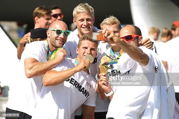 Gold medallists Ronald Rauhe Tom Liebscher Max Rendschmidt Marcus Gross and Max Hoff are seen during the arrival of German Summer Olympic Athletes...