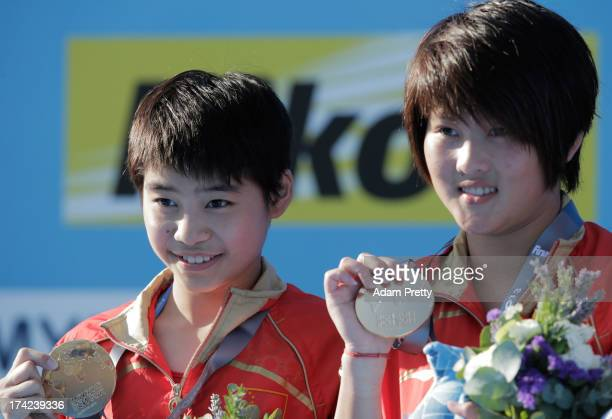 Gold medallists Ruolin Chen and Huixia Liu of China celebrate after winning the Women's 10m Springboard Diving final on day three of the 15th FINA...