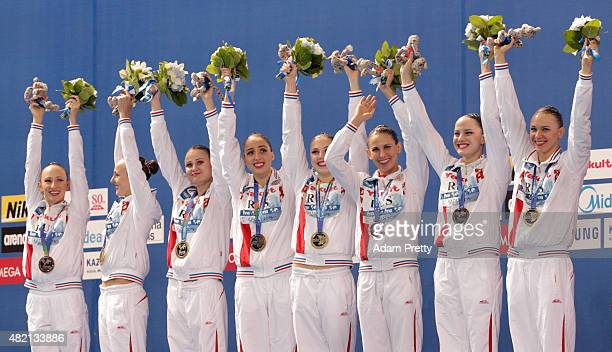 Gold medallists Russia celebrate during the medal ceremony for the Women's Team Technical Synchronised Swimming Final on day three of the 16th FINA...