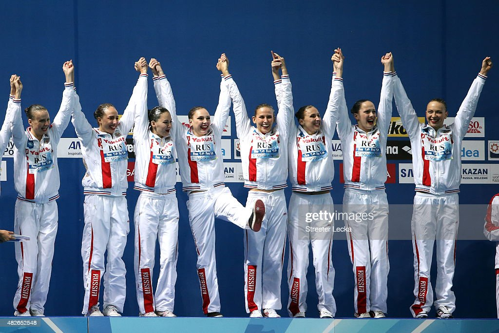 Gold medallists Russia celebrate during the medal ceremony for the Women's Free Combination Synchronised Swimming Final on day eight of the 16th FINA World Championships at the Kazan Arena on August 1, 2015 in Kazan, Russia.