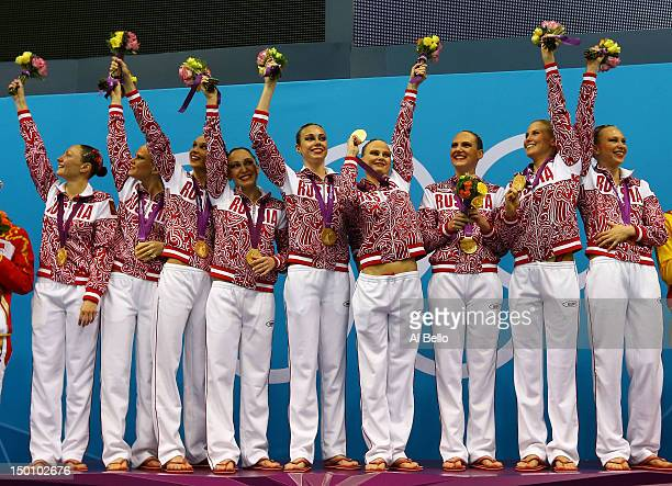 Gold medallists Russia celebrate on the podium during the medal ceremony for the Women's Teams Synchronised Swimming Free Routine final on Day 14 of...