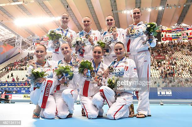 Gold medallists Russia pose during the medal ceremony for the Women's Team Technical Synchronised Swimming Final on day three of the 16th FINA World...
