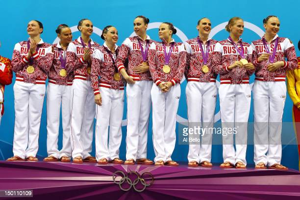 Gold medallists Russia pose on the podium during the medal ceremony for the Women's Teams Synchronised Swimming Free Routine final on Day 14 of the...