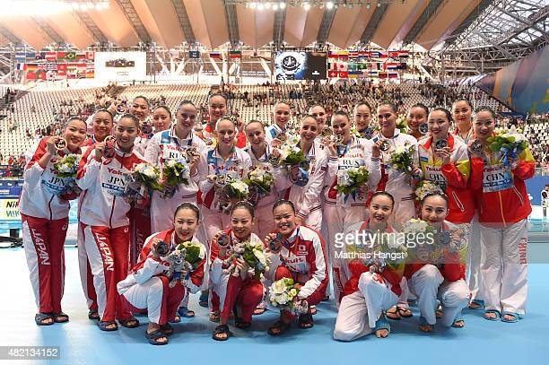 Gold medallists Russia pose with silver medallists China and bronze medallists Japan during the medal ceremony for the Women's Team Technical...