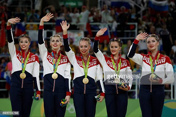 Gold medallists Russia's team pose on the podium of the group all-around final event of the Rhythmic Gymnastics at the Olympic Arena during the Rio...