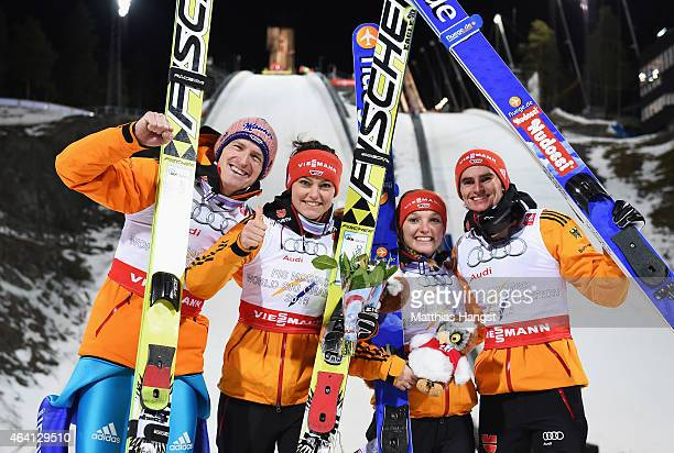 Gold medallists Severin Freund Carina Vogt Katharina Althaus and Richard Freitag of Germany celebrate after the Mixed Team HS100 Normal Hill Ski...