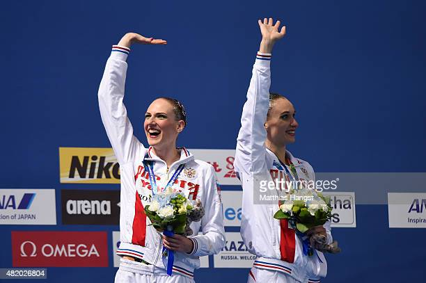 Gold medallists Svetlana Romashina and Natalia Ishchenko of Russia celebrate during the medal ceremony for the Women's Duet Technical Synchronised...