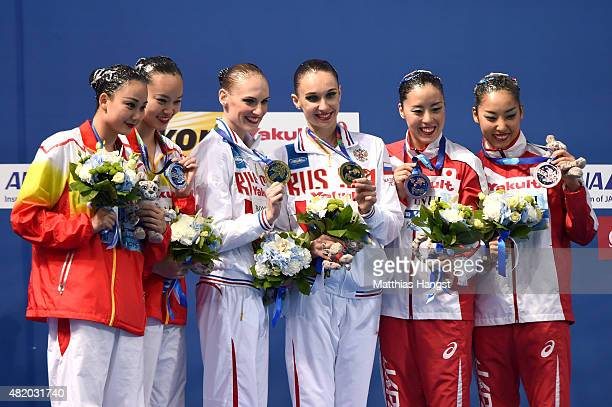 Gold medallists Svetlana Romashina and Natalia Ishchenko of Russia pose with silver medallists Xuechen Huang and Wenyan Sun of China and bronze...