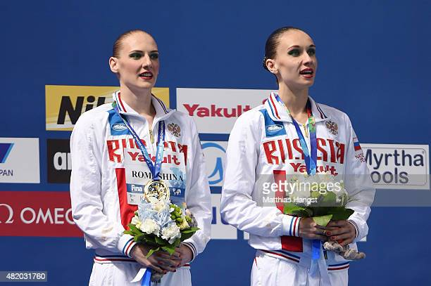Gold medallists Svetlana Romashina and Natalia Ishchenko of Russia pose during the medal ceremony for the Women's Duet Technical Synchronised...