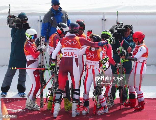 Gold medallists Switzerland are congratulated by silver medallists Austria during the Alpine Team Event Big Final on day 15 of the PyeongChang 2018...