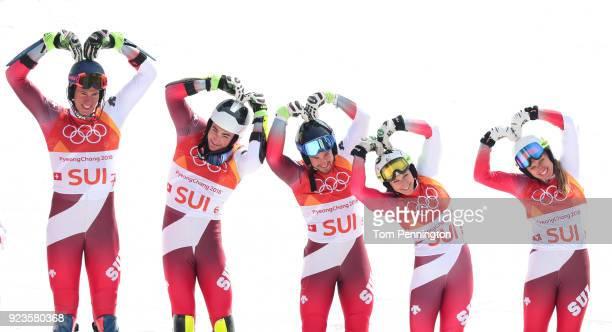 Gold medallists Switzerland with Ramon Zenhaeusern Daniel Yule Luca Aerni Wendy Holdener and Denise Feierabend celebrate during the victory ceremony...