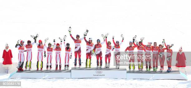 Gold medallists Switzerland with Ramon Zenhaeusern Daniel Yule Luca Aerni Wendy Holdener and Denise Feierabend celebrate with silver medallists...