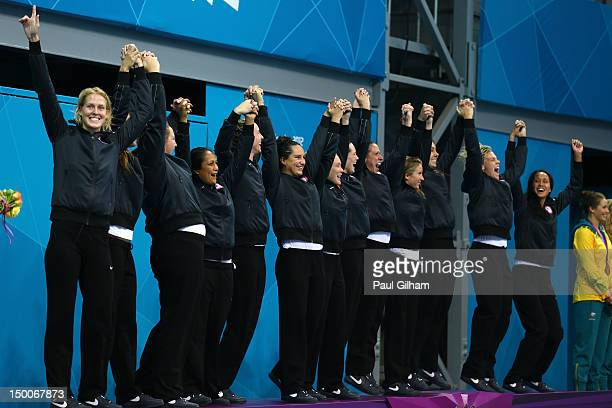 Gold medallists the United States celebrate on the podium during the medal ceremony for the Women's Water Polo on Day 13 of the London 2012 Olympic...