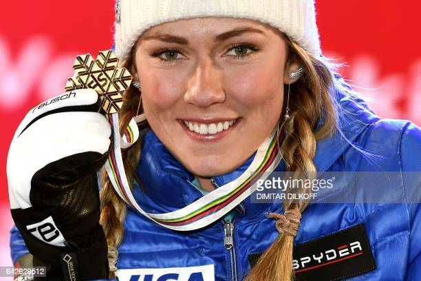 Gold medallists US skier Mikaela Shiffrin poses on the podium of the women's slalom race at the 2017 FIS Alpine World Ski Championships in St Moritz...
