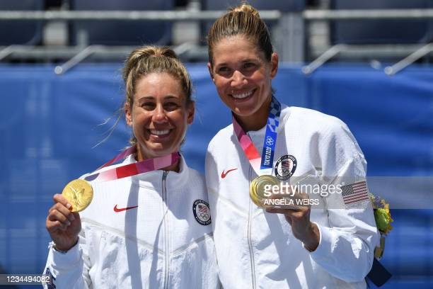 Gold medallists USA's April Ross and Alix Klineman pose with their medals after the victory ceremony of the women's beach volleyball event during the...