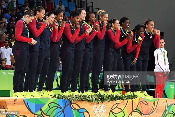Gold medallists USA's guard Lindsay Whalen USA's forward Seimone Augustus USA's guard Sue Bird USA's forward Maya Moore USA's small forward Angel...