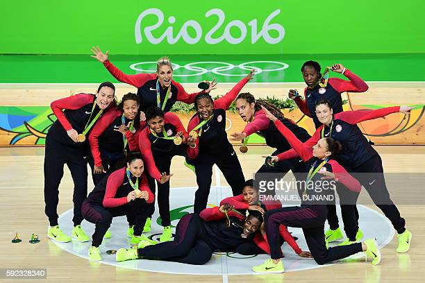 TOPSHOT Gold medallists USA's guard Lindsay Whalen USA's guard Sue Bird USA's forward Seimone Augustus USA's forward Maya Moore USA's power forward...