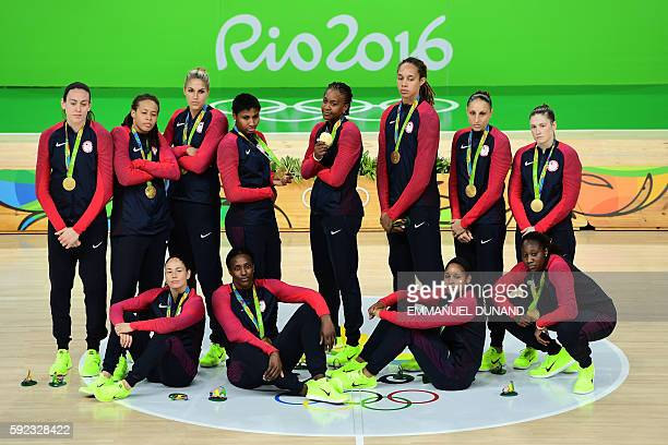 Gold medallists USA's guard Lindsay Whalen USA's guard Sue Bird USA's forward Seimone Augustus USA's forward Maya Moore USA's power forward Breanna...
