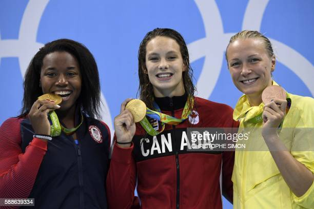 Gold medallists USA's Simone Manuel and Canada's Penny Oleksiak pose with bronze medallist Sweden's Sarah Sjostrom on the podium of the Women's 100m...