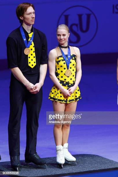 Gold medallists Yevgenia Tarasova and Vladimir Morozov of Russia at an awards ceremony for the pairs' competition at the 2018 ISU European Figure...