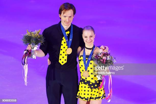 Gold medallists Yevgenia Tarasova and Vladimir Morozov of Russia pose with their awards during the awards ceremony for the pairs' competition at the...