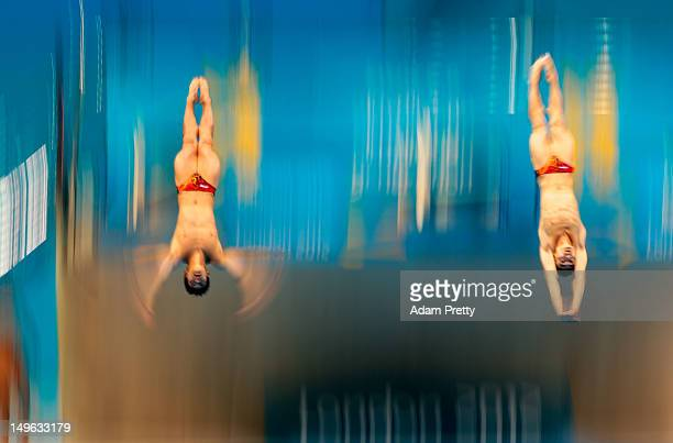 Gold medallists Yutong Luo and Kai Qin of China pose on the podium during the medal ceremony for the Men's Synchronised 3m Springboard final on Day 5...
