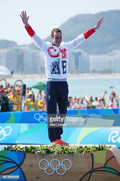 Gold medaltist Alistair Brownlee of Great Britain celebrates on the podium during the Men's Triathlon at Fort Copacabana on Day 13 of the 2016 Rio...
