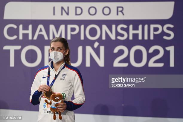 Gold medlist Britain's Amy-Eloise Markovc celebrates on the podium during the medal ceremony for the women's 3000m at the 2021 European Athletics...