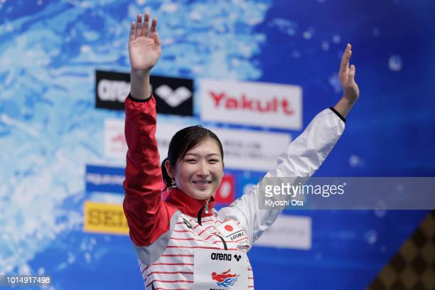 Gold medlist Rikako Ikee of Japan celebrates on the podium at the medal ceremony for the Women's 100m Butterfly Final on day three of the Pan Pacific...