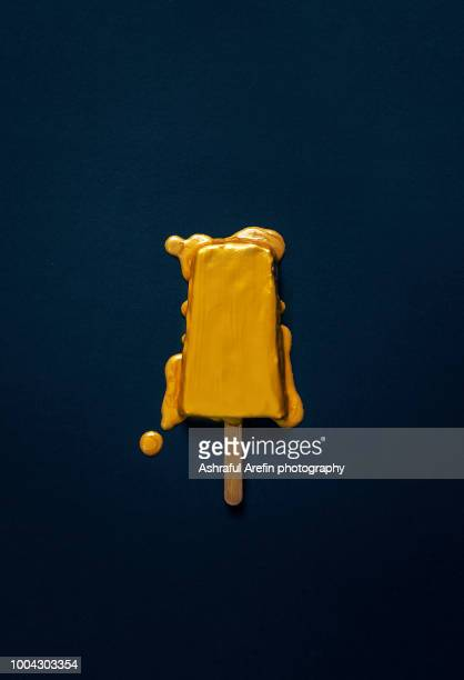 gold melting popsicle - gold colored stock photos and pictures