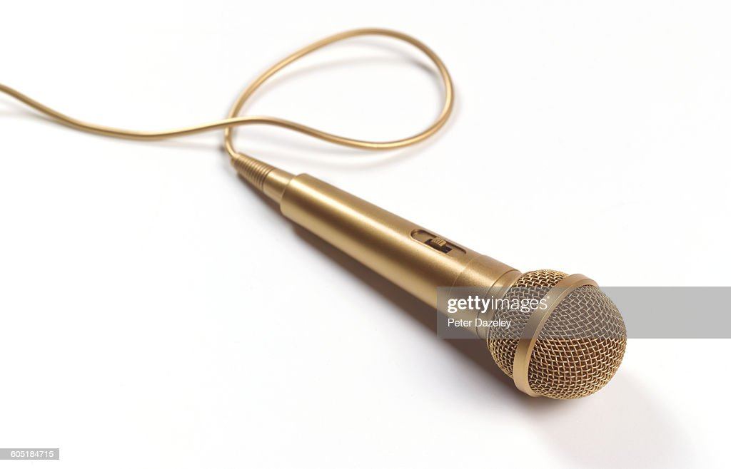 Gold microphone with copy space : Foto de stock