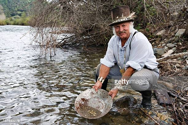 gold miner on american river h - gold rush stock photos and pictures