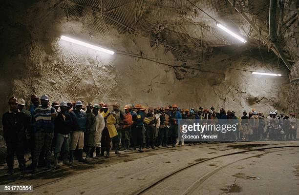 Gold miners at Great Noligwa mine queuing at the end of their shift to take the mine shaft lifts back to the surface An estimated 30% of South...
