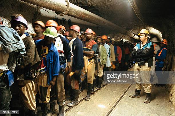 Gold miners at the Great Noligwa mine queuing at the end of their shift to take the mine shaft lifts back to the surface An estimated 30% of South...