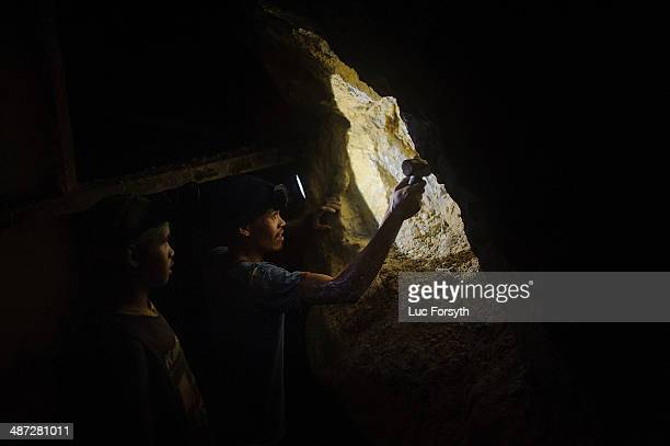 Gold miners probe the tunnel walls with a sledge hammer speculating about the gold content of the rock If a tunnel does not regularly produce gold...