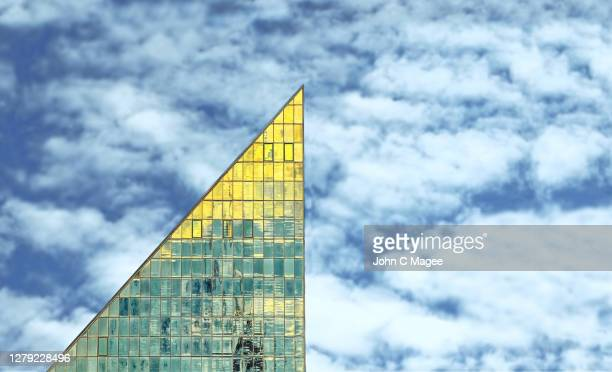 gold modernist triangle - tower stock pictures, royalty-free photos & images