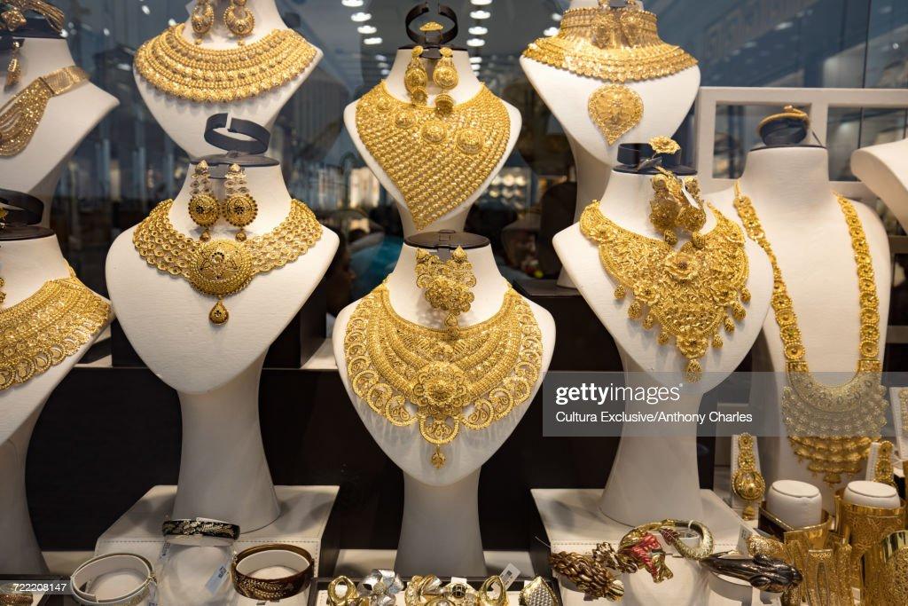 Gold necklaces in shop window at the gold souk, Deira, Dubai, United Arab Emirates : ストックフォト
