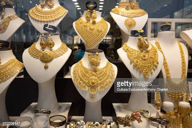 Gold necklaces in shop window at the gold souk, Deira, Dubai, United Arab Emirates