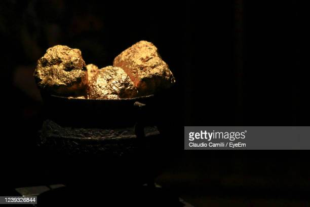 gold nuggets within an ancient vase. - gold coloured stock pictures, royalty-free photos & images