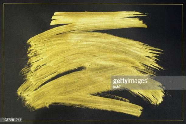 gold paint stroke - aaien stockfoto's en -beelden