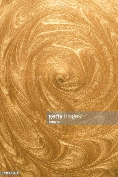 Gold Paint Swirl Pattern