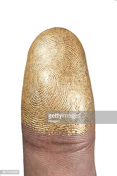 gold painted adult thumb finger - body paint stock pictures, royalty-free photos & images